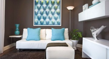blue and brown living room with white furniture