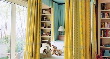 blue and gold bedroom with canopied bed for kids