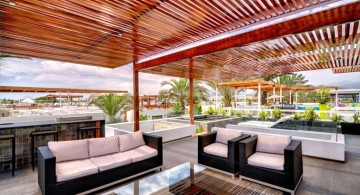 bright colored rooftop modern deck design with monochrome furnitures