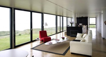 contemporary minimalist long living room ideas in monochrome with red chair accent