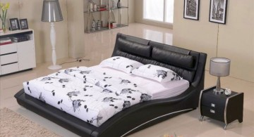 curved bed designs in black with white linen