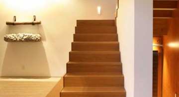 floating wooden stairs with wall railing