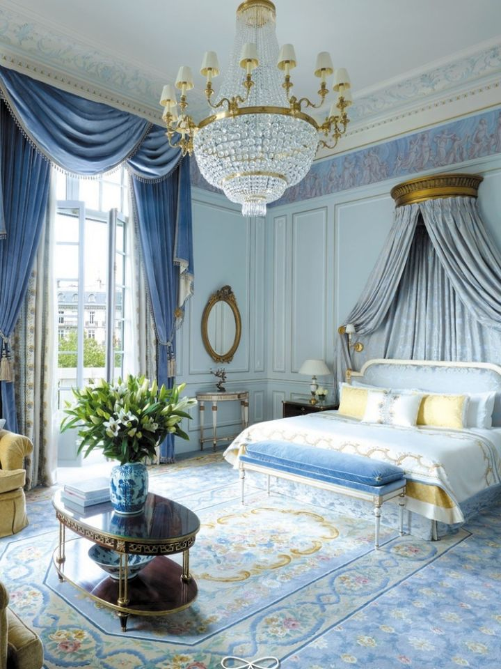 Glamorous Blue And Gold Bedroom With Heavy Chandelier