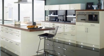 green wall and laminated white cabinets popular paint colors for kitchen