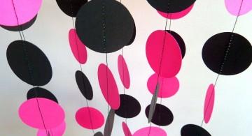 hanging circles pink and black wall decor