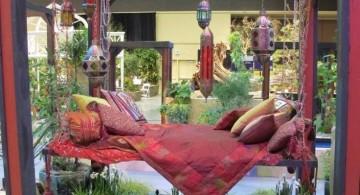 hanging swing bed in a flower garden