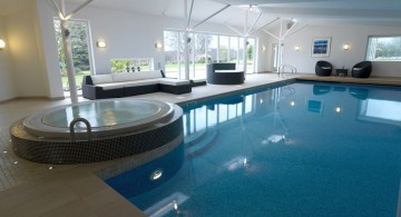 indoor swimming pool with glass doors and jacuzzi