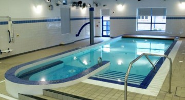 indoor swimming pool with track lighting