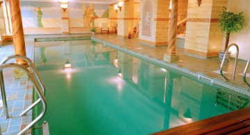 indoor swimming pool with wooden deck