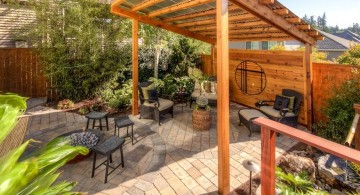 japanese style backyard with rustic pergola and bamboo fountain