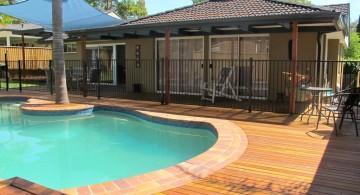 kidney shaped swimming pools on wood deck