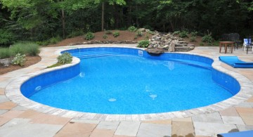 kidney shaped swimming pools with stone deck