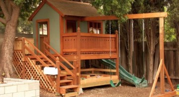 luxury outdoor playhouse with swing and slide