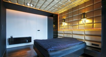 modern blue and gold bedroom with textured wall and ceiling