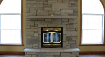 modern fireplace designs with glass in a brick wall