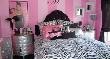 pink and black bedroom decor with vintage picture