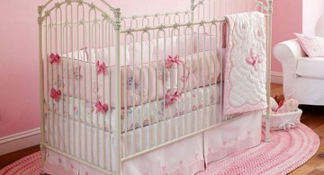 pink baby room ideas with simple accent on oval rug