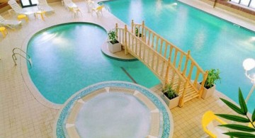 pool shapes and designs with bridge and seating area for indoor pools