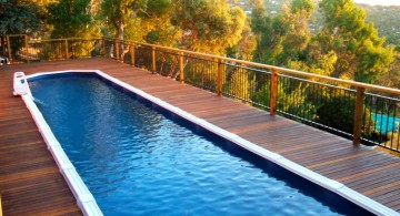 rooftop lap pool designs with wood deck