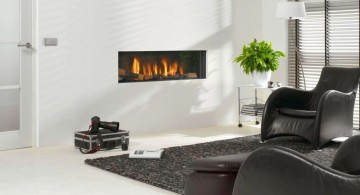 sleek built in with black leather chairs modern white fireplace design