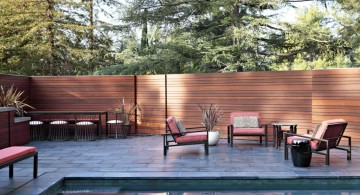 sleek modern deck design for poolside with sidepool chairs