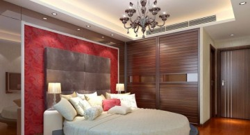 sleek tray ceiling bedroom with intage chandelier