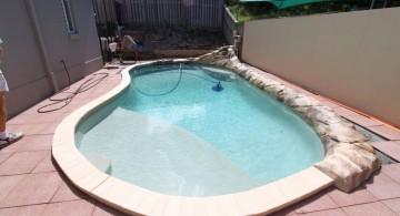 small kidney shaped swimming pools for narrow yard