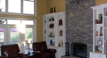 stack stone fireplaces for high ceilinged room