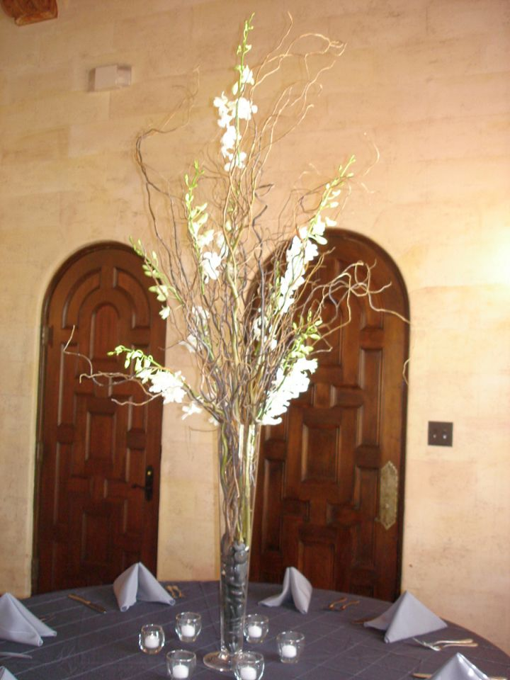 Tall Vase With Branches As Center Piece