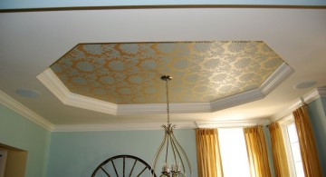 tray ceiling bedroom with romantic pattern and chandelier