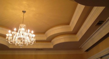 tray ceiling bedroom with spider chandelier