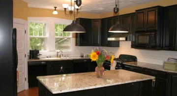 two blacks wide mini pendant lights over kitchen island