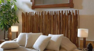 unique tree branch bed with stacked branch as headbed