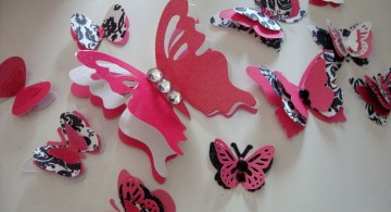 various sized butterflies pink and black wall decor