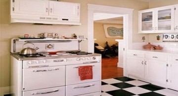 vintage and retro kitchen design with white cabinets and big checkered tiles