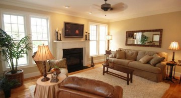 warm and cozy earth tone living room with fireplace