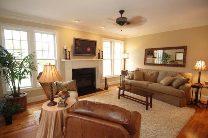 So What Do You Think About Warm And Cozy Earth Tone Living Room With Fireplace Above It S Amazing Right Just Know That Photo Is Only One Of 20