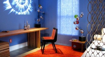 Boys room color in blue with space themed wall painting