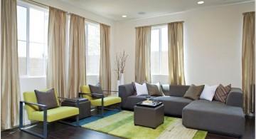 Grey and Green living rooms with dark wooden floor