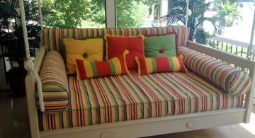 Outdoor swinging beds rainbow stripes