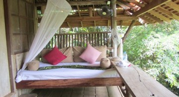 Outdoor swinging beds with a fan