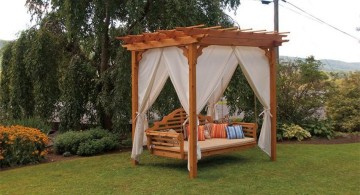 Outdoor swinging beds with curtains