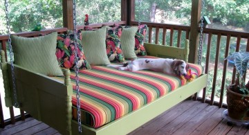 Outdoor swinging beds with rainbow and flowers