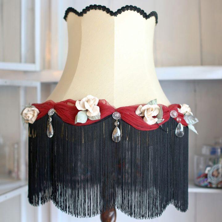 Rosette lamp shade with black fringe