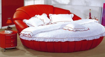 Striking red round bed frame design topped with chic white bedding