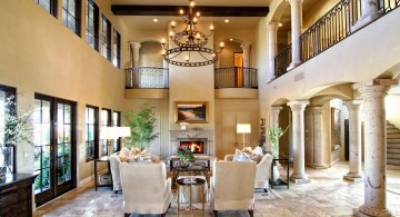 Tuscan living room decor with tall ceiling and chandelier
