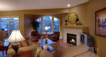 Tuscan living room decor with white fireplace