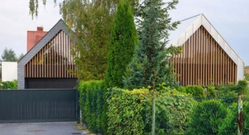 Two Barn House entrance wide view by RS+ Architecture, Poland