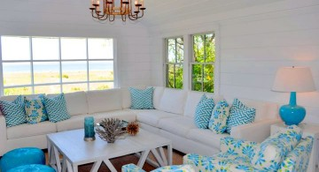 bright turquoise living room decor with lovely chandelier