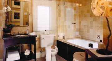 brown bathrooms with unique lamp